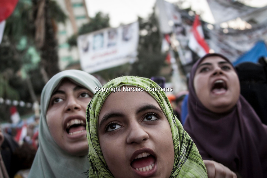 In this Friday, Aug. 09, 2013 photo, female supporters of the ousted president Mohammed Morsi demonstrate in the streets nearby Al-Raba'a Alawya mosque in the Nasr district of Cairo. (Photo/Narciso Contreras).