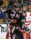 Robbie Vrolyk (NU - 91) - The Northeastern University Huskies defeated the Boston University Terriers 3-2 in the opening round of the 2013 Beanpot tournament on Monday, February 4, 2013, at TD Garden in Boston, Massachusetts.