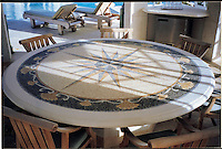Mustique table top in hand chopped tumbled Blue Macauba, Blue Bahia, Giallo Reale, Renaisance Bronze, Travertine White