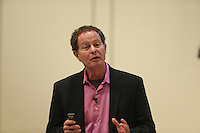 Whole Foods CEO Jack Mackey speaks at the UVa Darden School of Business