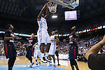 16 November 2014: North Carolina's Joel James dunks the ball. The University of North Carolina Tar Heels played the Robert Morris University Colonials in an NCAA Division I Men's basketball game at the Dean E. Smith Center in Chapel Hill, North Carolina. UNC won the game 103-59.