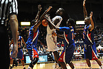 Ole Miss' Terrance Henry (1) is fouled against SMU's Leslee Smith (3) and SMU's Ryan Manuel (1) at the C.M. &quot;Tad&quot; Smith Coliseum in Oxford, Miss. on Tuesday, January 3, 2012. Ole Miss won 50-48.
