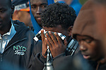 An African immigrant protestor reacts as protestors are arrested in front of the Israeli parliament, the Knesset, in Jerusalem, Israel. Some 200 African asylum-seekers, who illegally entered Israel, demonstrated against their condition at a detention facility, from which they walked out of two days earlier. Israeli police and immigration arrested all protestors, and sent them back to Saharonim detention facility in the Negev desert.