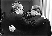 United States President Gerald R. Ford shares a moment of quiet congratulations with his soon-to-be Vice President, Nelson Rockefeller, just after the United States House of Representatives vote confirming Rockefeller.  The nominee's wife, Happy, is in the background of this scene on the second floor of The White House in the Residence in Washington, D.C. on December 12, 1974<br /> Mandatory Credit: David Hume Kennerly / White House via CNP