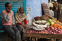 Agra, India.  Street Scene.  Elderly Couple Selling Onions, Tomatoes, Garlic, and Cabbage.