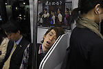 _SAM4641, British Airways, Tokyo, Japan, 10/2008, JAPAN-10135. A man sleeps on the train.