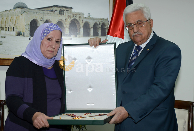 Palestinian President Mahmoud Abbas (Abu Mazen) gives martyr Sakhr Habash, Sam star of Jerusalem in the West Bank city of Ramallah, on Oct. 05 ,2013. Photo by Thaer Ganaim
