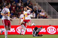 Joel Lindpere (20) of the New York Red Bulls jumps over a tackle by Rafael Baca (30) of the San Jose Earthquakes during the second half. The New York Red Bulls and the San Jose Earthquakes played to a 2-2 tie during a Major League Soccer (MLS) match at Red Bull Arena in Harrison, NJ, on April 14, 2012.