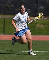 Corey Donohoe (7) of North Carolina looks for a pass during the ACC women's lacrosse tournament semifinals in College Park, MD.  North Carolina defeated Duke, 14-4.
