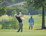 Golfer John Merrick swings on the 1st hole at the PGA FedEx St. Jude Classic at TPC Southwind in Memphis, Tenn. on Thursday, June 9, 2011. Merrick shot a 4-under 66.