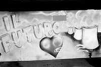 Switzerland. Canton Ticino. Lugano. Graffiti on a wall. A heart and a nuclear power plant. The words written in italian say: Il Fututo (the future). 23.02.07  © 2007 Didier Ruef