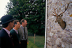 'QUANTOCK STAG HOUNDS', QUANTOCK, SOUTH SOMERSET. A STAGS ANTLERS ARE DISPLAYED ON THE COTTAGE WALL AT ANNUAL PUPPY SHOW, 1997