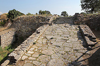 Fortification wall and the partially restored ramp of the Troia II citadel, 2600-2250 BC, in the ruins of the Homeric city of Troy, Hill of Hissarlik, Turkey. The citadel entrance was approached by an impressive ramp paved with flat stones and flanked by mudbrick walls. Troy was a city, both factual and legendary, in northwest Anatolia and was the setting of the Trojan Wars described in Homer's Iliad. Picture by Manuel Cohen