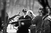 Machine Gun Shoot<br /> Knob Creek<br /> Westpoint, Kentucky<br /> USA<br /> April 4, 2009<br /> <br /> Nearly 16,000 people attend the Knob Creek Machine Gun Shoot &amp; Military Gun Show. It is the largest gathering of Civilian owned machine guns in the world. The gun show has over 700 tables with machine guns, military surplus, ammo, hard to find parts &amp; pieces and regular firearms and supplies.<br /> <br /> Firearms sales have surged in the six months since Obama's election as millions of Americans have gone on a buying spree that has stripped gun shops in some parts of the country almost bare of assault weapons and led to a national ammunition shortage.<br /> <br /> The FBI says that since November more than seven million people applied for criminal background checks in order to buy weapons, a figure excluding the many more buying at thousands of gun shows in states such as Virginia, without facing any checks.<br /> <br /> Gun-shop owners and the National Rifle Association say the surge is driven by worries that Obama is planning to ban many types of firearms and that the deepening economic crisis will fuel a crime wave, as witnessed by the string of mass shootings in the past few weeks.<br /> <br /> But control groups pressing for greater control on firearms accuse the NRA of funding a massive scare campaign to portray Obama as a gun owner's worst nightmare and to argue that tighter restrictions on weapons ownership are a threat to broader liberties and a step toward tyranny.