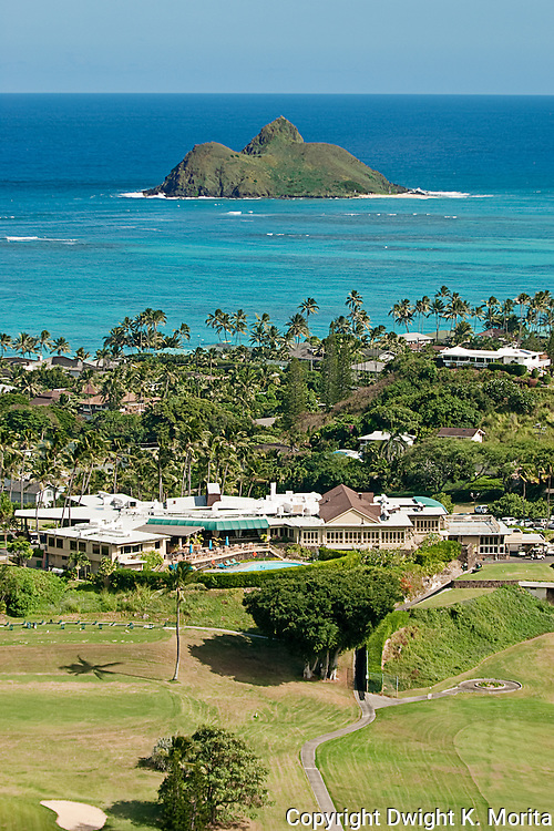 Mid-Pacific Country Club clubhouse in the foreground with one of the Mokulua Islands looming in the tourquoise waters of the Pacific
