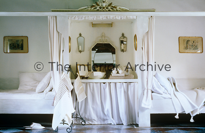 In this bedroom twin beds have been constructed on either side of a central dressing table