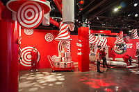 "Visitors to the Target ""Wonderland!"" pop-up store in the Meatpacking District in New York on its grand opening day, Wednesday, December 9, 2015. According to Target the store combines physical and digital shopping using medallions given to visitors with an embedded RFID chip. Tapping the chip to an antenna near the product lets you order it. The store is an experiment in technology replacing shopping carts with chips.  (© Richard B. Levine)"