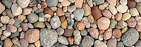 A close up panoramic of Lake Michigan rocks in a variety of pastel colors and shapes that makes a good decorating neutral. A tranquil nature and environmental image for home and office decor. Available in 20x60 and 12x36 gallery wrapped canvas.