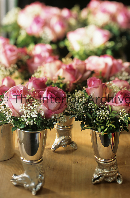 Delicate bunches of roses in small silver vases at the Hotel & Spa Rosa Alpina in the Dolomites