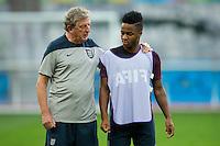 England manager Roy Hodgson talks to Raheem Sterling during training