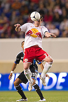 Kenny Cooper (33) of the New York Red Bulls goes up for a header during the first half against the San Jose Earthquakes during a Major League Soccer (MLS) match at Red Bull Arena in Harrison, NJ, on April 14, 2012.