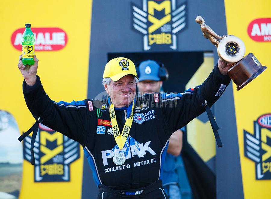Mar 19, 2017; Gainesville , FL, USA; NHRA funny car driver John Force celebrates after winning the Gatornationals at Gainesville Raceway. Mandatory Credit: Mark J. Rebilas-USA TODAY Sports