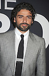 "actor Oscar Isaac attends the World Premiere of ""The Bourne Legacy"" on July 30, 2012 at The Ziegfeld Theatre in New York City. The movie stars Jeremy Renner, Rachel Weisz, Edward Norton, Stacy Keach, Dennis Boutsikaris and Oscar Isaac."