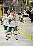16 February 2008: University of Vermont Catamounts' forward and team Captain Dean Strong, a Junior from Mississauga, Ontario, gets congrats from teammates on the bench during a game against the Merrimack College Warriors at Gutterson Fieldhouse in Burlington, Vermont. The Catamounts defeated the Warriors 2-1 for their second win of the 2-game weekend series...Mandatory Photo Credit: Ed Wolfstein Photo