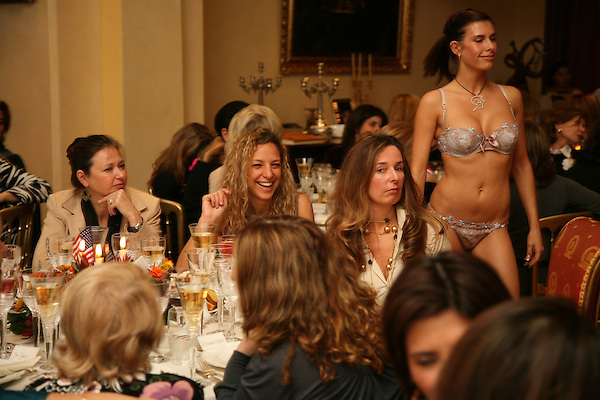 A model displays underwear during a ladies tea party at a private home in Kensington