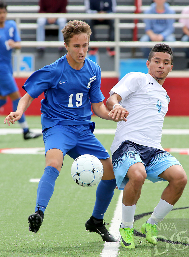 NWA Democrat-Gazette/DAVID GOTTSCHALK  Springdale Har-Ber Wildcats' Cristian Flores fights with Conway Wampus Cats' Jackson Goodwin during first half play at the 7A 2017 State Soccer Tournament at Mayo-Thompson Stadium at Fort Smith Northside High School. Springdale Har-Ber won 2-0.