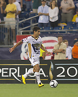 Pumas UNAM defender Luis Fuentes (33) brings the ball forward. The New England Revolution defeated Pumas UNAM in SuperLiga group play, 1-0, at Gillette Stadium on July 14, 2010.