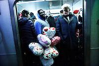 A man carries globes for his girlfriend inside the subway during Valentine's Day in New York, Feb 14, 2014. VIEWpress/Eduardo Munoz Alvarez