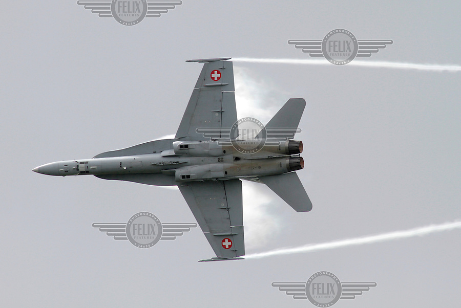 A Swiss F-18 Hornet gives an air display during Tiger Air show.  Nato Tiger Meet is an annual gathering of squadrons using the tiger as their mascot. While originally mostly a social event it is now a full military exercise. Tiger Meet 2012 was held at the Norwegian air base &Oslash;rlandet.
