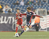 New England Revolution midfielder Scott Caldwell (6) passes the ball.  In a Major League Soccer (MLS) match, the New England Revolution (blue) defeated Toronto FC (red), 2-0, at Gillette Stadium on May 25, 2013.