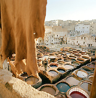 Men working and dyeing leather in the Tannery in Fes, Morocco