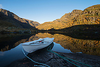 Rowboat on shore of lake Trolldalsvatnet, Moskenesøy, Lofoten Islands, Norway