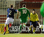 Josh McQuoid races in past David Gray to score the opening goal for Northern Ireland