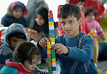 "A boy plays with blocks inside a ""child-friendly space"" in a refugee processing center in the Serbian village of Presevo, not far from the Macedonian border. Hundreds of thousands of refugees and migrants--including many children--have flowed through Serbia in 2015, on their way from Syria, Iraq and other countries to western Europe."