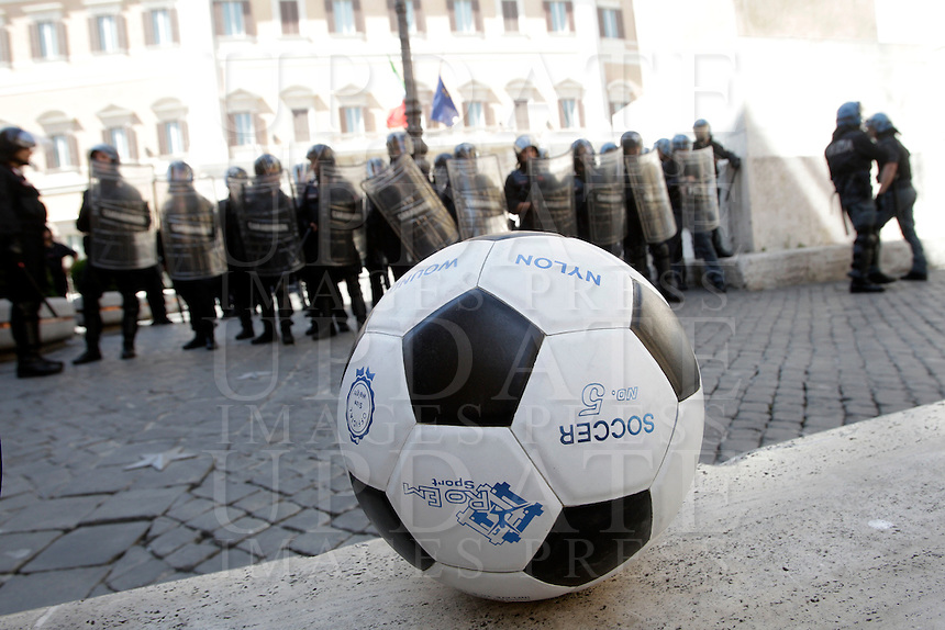 "Un pallone calciato dai dimostranti a Montecitorio durante la protesta ""No rigore"" contro il ddl sul lavoro, Roma, 14 giugno 2012..Antiriot Police and Carabinieri officers are seen behind a soccer ball kicked by demonstrators towards the Lower Chamber building during the ""No Penalty"" (meant as ""No uprightness"") protest against the law by decree on labour, in Rome, 14 june 2012..UPDATE IMAGES PRESS/Riccardo De Luca"