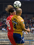Mexico (27.08.2006) UNAM Pumas defender Dario Veron (R) fights for the ball with Toluca Diablos Rojos forward  Bruno Marioni during their soccer match at the University Stadium in Mexico City, August, 27, 2006. UNAM Pumas tied 0-0 to Toluca.   © Photo by Javier Rodriguez