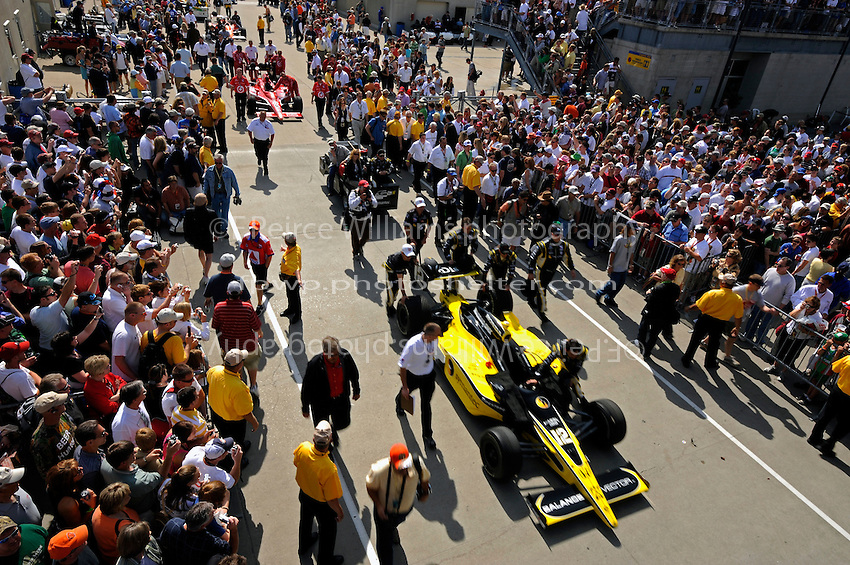 25 May 2008, Indianapolis,Indiana USA.The cars are rolled out of Gasoline Alley to the grid on race morning as the gathered crowd looks on..©2008 Tessa Tillet USA.
