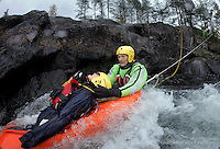 Norwegian Air Ambulance training area Camp Torpomoen. Pilots, doctors and rescue paramedics practice various skills during a week of coordinated training. River rescue training Rescue paramedic Espen Somdalen Witz¯e