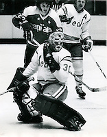 Seal goalie Gary Simmons, behind him is Len Frig and Washington's Mike Bloom. (1974 photo by Ron Riesterer)