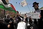 Ultra-orthodox Jews from 'Neturei Karta', a Haredi sect opposing Zionism and the state of Israel, protest alongside Palestinians after Israeli rightwing activists have marched in defiance in the Palestinian village of Silwan, east Jerusalem.