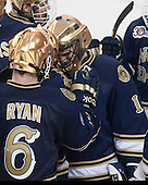 Andy Ryan (ND - 6) and Steven Summerhays (ND - 1) celebrate the win. - The visiting University of Notre Dame Fighting Irish defeated the Boston College Eagles 7-2 on Friday, March 14, 2014, in the first game of their Hockey East quarterfinals matchup at Kelley Rink in Conte Forum in Chestnut Hill, Massachusetts.