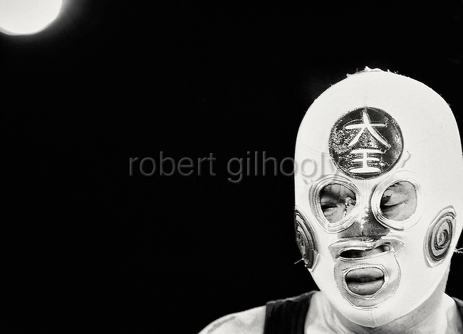 A wrestler's mask is bloodied during a bout  at Doglegs, an event for wrestlers with physical and mental handicaps in Tokyo, Japan.