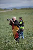 Plane spotter holds a German flag to attract the attention of German pilots passing by. Nato Tiger Meet is an annual gathering of squadrons using the tiger as their mascot. While originally mostly a social event it is now a full military exercise. Tiger Meet 2012 was held at the Norwegian air base Ørlandet.