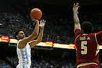 30 January 2016: North Carolina's Joel Berry II (left) shoots over Boston College's Garland Owens (5). The University of North Carolina Tar Heels hosted the Boston College Eagles at the Dean E. Smith Center in Chapel Hill, North Carolina in a 2015-16 NCAA Division I Men's Basketball game. UNC won the game 89-62.