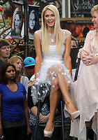 "Paris Hilton .Gabriel Mann And Kathy And Paris Hilton Fashion Show On ""Extra"" Held at The Grove, West Hollywood, California, USA..May 2nd, 2012.full length white sheer dress tulle sitting.CAP/ADM/KB.©Kevan Brooks/AdMedia/Capital Pictures."