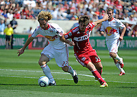 New York defender Stephen Keel (22) battles for the ball with Chicago forward Diego Chaves (99).  The Chicago Fire tied the New York Red Bulls 1-1 at Toyota Park in Bridgeview, IL on June 26, 2011.